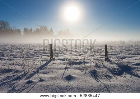 Barbed Wire Fence With Snow Covered Ground