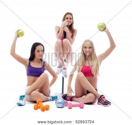 Funny sportswomen posing with sports equipment