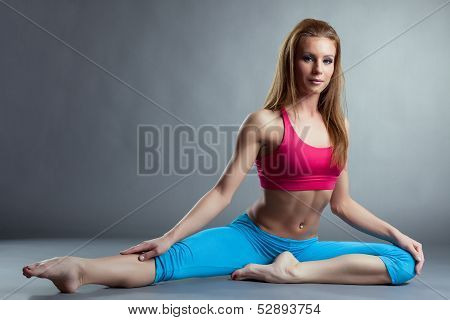 Image of pretty athlete girl doing stretching