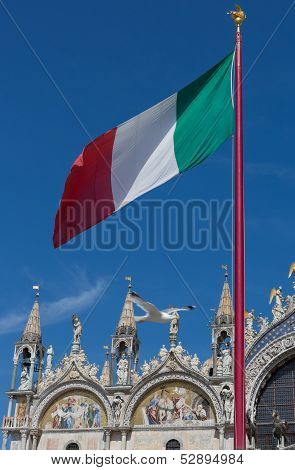 Italian Flag And Saint Mark's Basilica