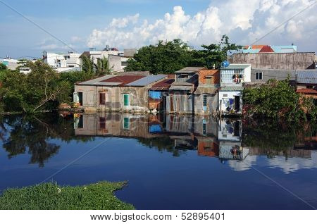 Houses refect on water