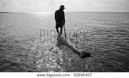 Man working at seaside