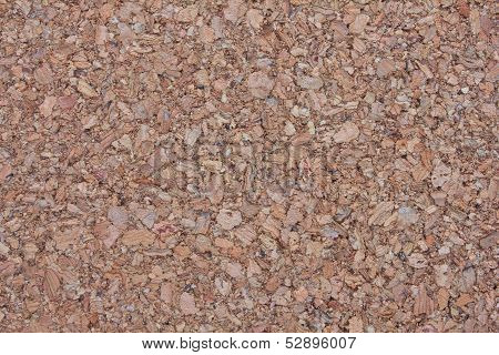 Background Surface Of Compressed Brown Wood Splinters And Sawdust