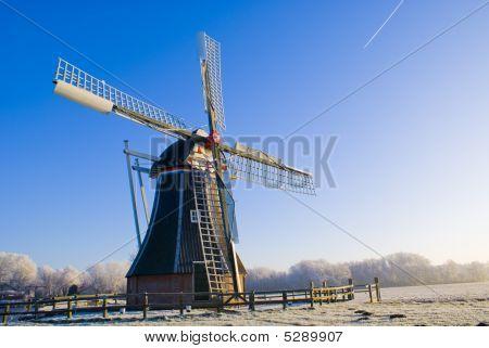 Windmill in a winter blue sky