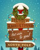 stock photo of pole  - Snow covered wooden sign - JPG
