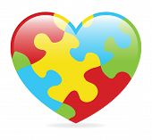 stock photo of puzzle  - A colorful heart made of symbolic autism puzzle pieces - JPG