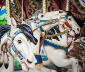 stock photo of carousel horse  - Colorful carousel horse on a merry go round - JPG
