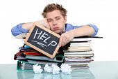 stock photo of boredom  - student swamped under work - JPG