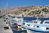 SYMI, GREECE - JUNE 17: Boats moored in Yialos harbour on June 17, 2011 on Symi island, Greece. Yial