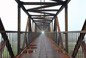 foto of skyway bridge  - Steel bridge for people with a mist - JPG
