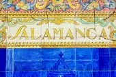 Salamanca sign over a mosaic wall