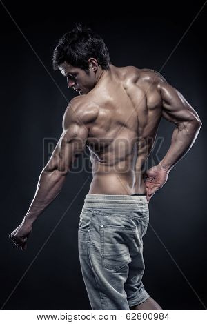 Strong Athletic Man Fitness Model Posing Back Muscles With Triceps