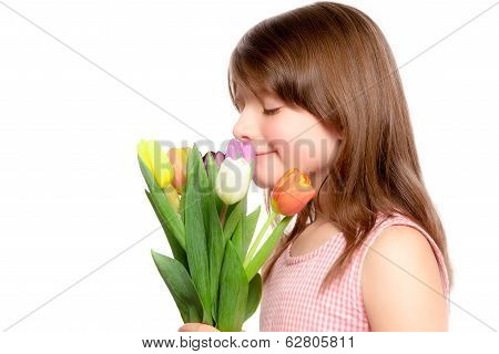 Young Girl Smelling A Bouquet Of Tulips