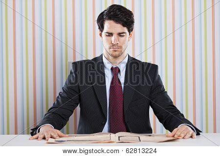 Businessman reading the newspaper