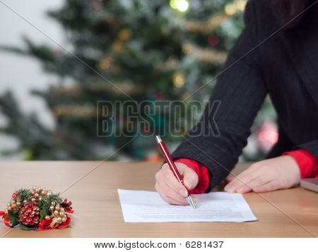 business woman with christmas list 2