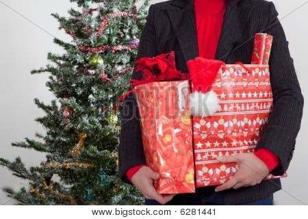 business woman with christmas gifts