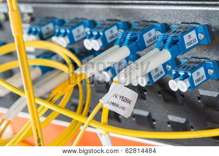 server with fiber optic  cables in data center