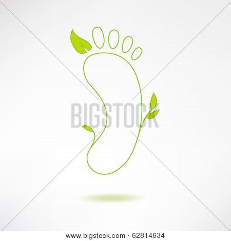 Foot logo with green leaf. Ecology and massage concept. Footprint icon isolated on stylish backgroun