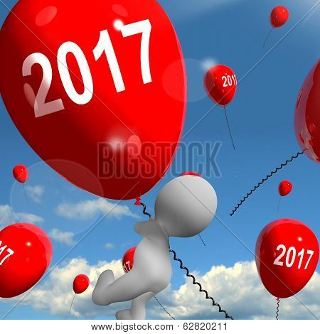 Two Thousand Seventeen On Balloons Shows Year 2017