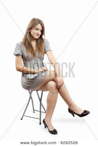 The Posing Young Girl In Grey Dress Over White