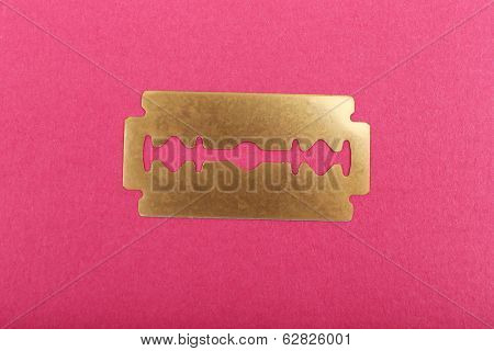 Razor blade on color background