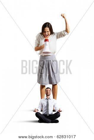 angry woman and calm yoga man over white background