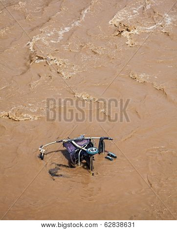 Pram, Baby Carriage In Muddy Water.