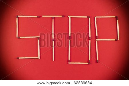 Word Stop Made Of Matchsticks