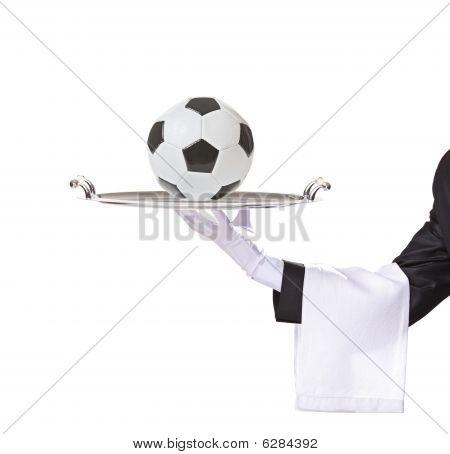 Waiter Holding A Silver Tray With A Football On It