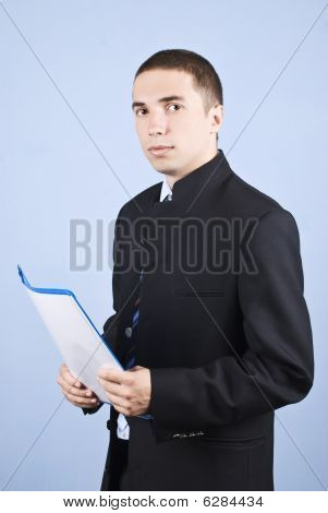 Serious Young Business Man With Folder