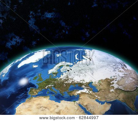 Planet Earth with sun rising over European countries (Elements of this image furnished by NASA)