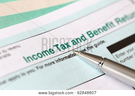 Income tax form and pen
