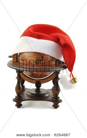 Old globe with Santa red holiday hat.