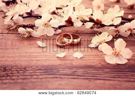 Bridal bouquet of white flowers on wooden surface
