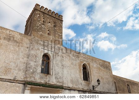 Stone Walls Of Old Fortress With Blue Sky. Madina, Tangier, Morocco