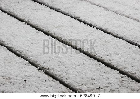 White Hail On Grey Table Outside In Perspective