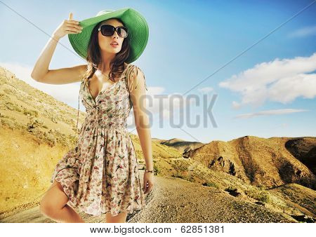 Portrait of pretty cheerful woman wearing hat