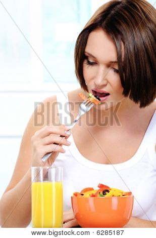 Girl Of Pleasant Appearance Eats Vegetable Salad