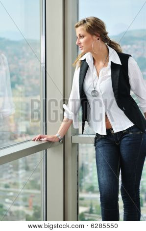 Woman Looking On Window