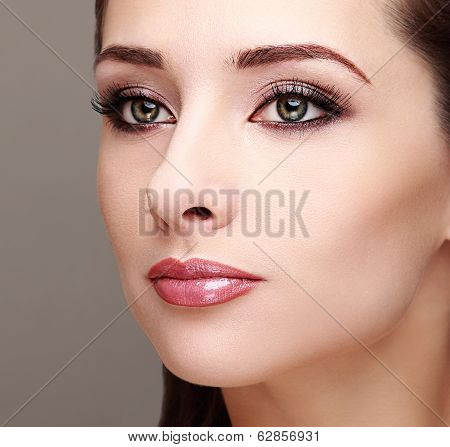 Beautiful Perfect Makeup Woman Face. Long Lashes And Smoky Green Make Eyes. Closeup