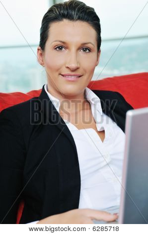Oung Business Woman Working On Laptop At Home