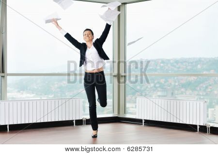 Young Business Woman Throw Papers In Air