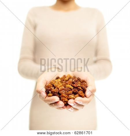 Golden berries. Superfoods - woman showing dried Inca berry, also called ground cherries. Heap of organic healthy golden berry super food.
