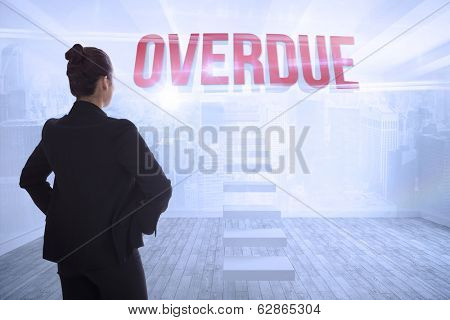 The word overdue and businesswoman with hands on hips against city scene in a room