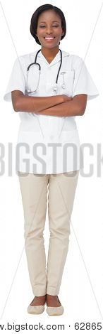 Young nurse in tunic with arms crossed on white background