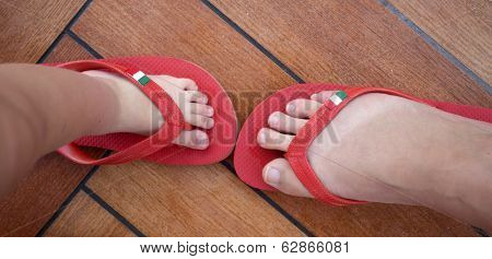 red flip flops with italian flag to symbolise family holidays