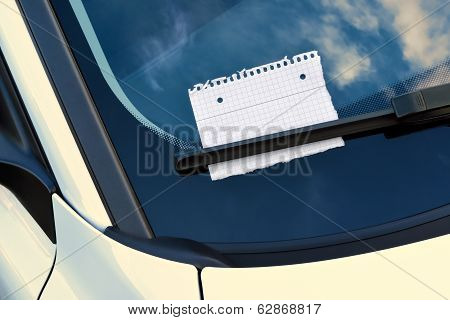 message under a windshield wiper