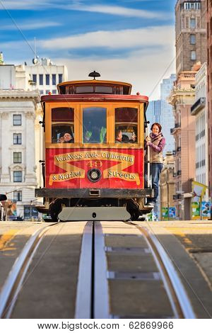 SAN FRANCISCO - NOVEMBER 26, 2010: Passengers enjoy a ride in a cable car in San Francisco, California. It is the oldest mechanical public transport in San Francisco which is in service since 1873.
