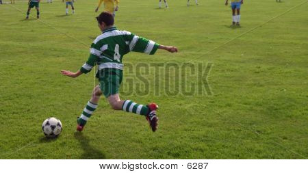 Boy Kicking The Ball