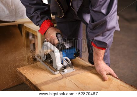 Hands Carpenter Working With Circular Saw